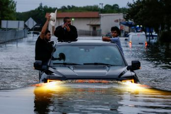 Residents use a truck to navigate through flood waters from Tropical Storm Harvey in Houston, Texas, U.S. August 27, 2017. REUTERS/Adrees Latif TPX IMAGES OF THE DAY
