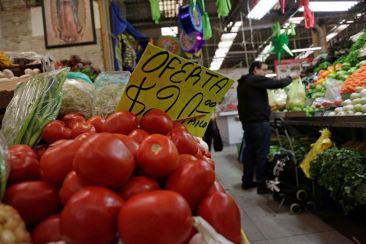 Tomatoes are pictured at a market stall in Mexico City, Mexico January 3, 2018. Picture taken January 3, 2018. REUTERS/Daniel Becerril
