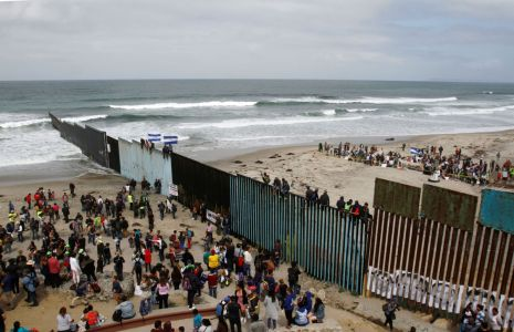 Members of a caravan of migrants from Central America and supporters gather on both sides of the border fence between Mexico and the U.S. as part of a demonstration, prior to preparations for an asylum request in the U.S., in Tijuana, Mexico April 29, 2018. REUTERS/Jorge Duenes