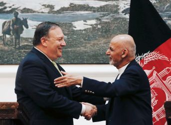 Afghan President Ashraf Ghani, and U.S. Secretary of State Mike Pompeo, shake hands during a news conference in Kabul, Afghanistan July 9, 2018. REUTERS/Omar Sobhani