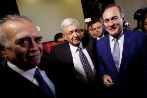 Mexico's president elect Andres Manuel Lopez Obrador (C) is flanked by president of the Business Coordinating Council (CCE) Juan Pablo Castanon (R) and top economic adviser and chief of staff nominee Alfonso Romo while arriving to a meeting in Mexico City, Mexico July 4, 2018. REUTERS/Daniel Becerril