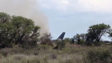 People gather near a site where an Aeromexico operated Embraer passenger jet crashed in Mexico's northern state of Durango, July 31, 2018, in this still image taken from a video obtained from social media. Contacto Hoy/via REUTERS THIS IMAGE HAS BEEN SUPPLIED BY A THIRD PARTY. MANDATORY CREDIT. NO RESALES. NO ARCHIVES.