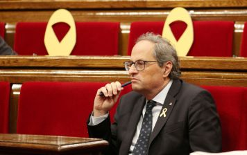 Catalan President Quim Torra attends a session vote on whether former Catalan President Carles Puigdemont and other members of his government can keep their seats as lawmakers while being under investigation or in prison on charges of rebellion, at Catalonian regional Parliament in Barcelona, Spain, October 2, 2018. REUTERS/Albert Gea