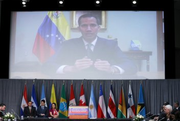 Venezuelan opposition leader and self proclaimed interim president Juan Guaido delivers a video message during the opening session of the Lima Group meeting in Ottawa, Ontario, Canada, February 4, 2019. REUTERS/Chris Wattie